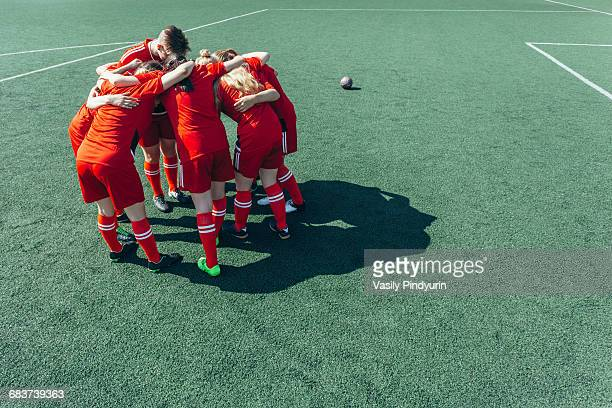 high angle view of soccer players huddling on field - federer photos et images de collection