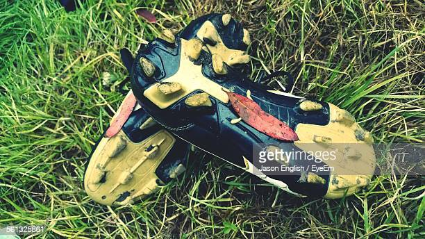High Angle View Of Soccer Shoes On Grassy Field