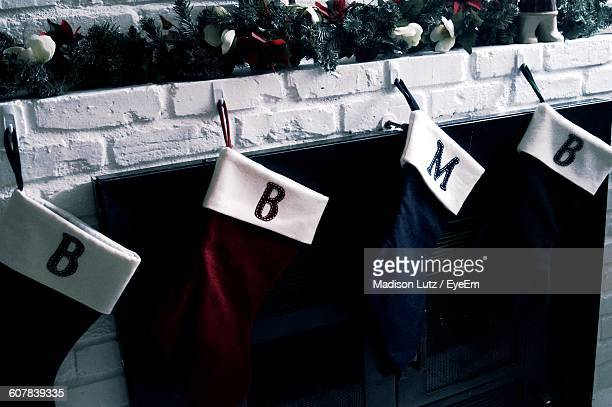 High Angle View Of Socks Hanging At Fireplace During Christmas