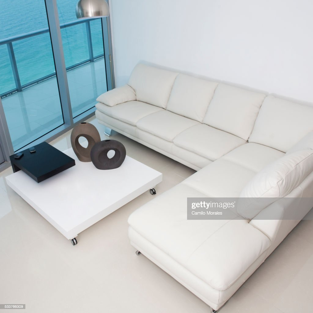 High angle view of sofa and coffee table in modern living room : Foto stock