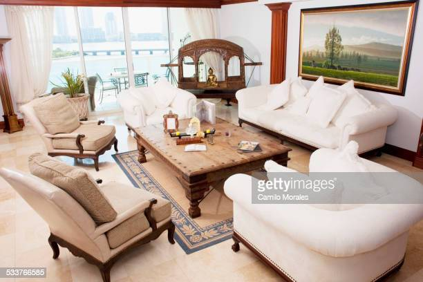 High angle view of sofas and armchairs in ornate living room