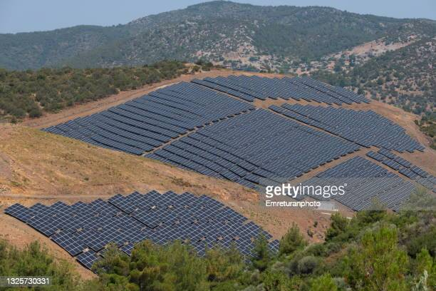 high angle view of solar panels on a hill. - emreturanphoto stock pictures, royalty-free photos & images