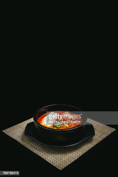 high angle view of soup in bowl against black background - korean food stock pictures, royalty-free photos & images