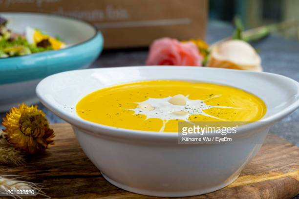 high angle view of soup in bowl on table - soup bowl stock pictures, royalty-free photos & images