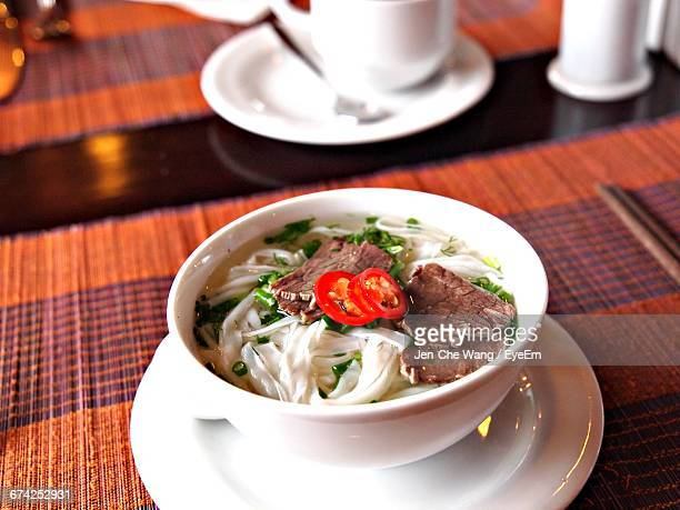 high angle view of soup served in bowl on table - frische stockfoto's en -beelden