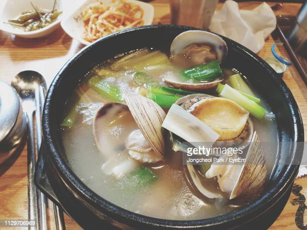 high angle view of soup served in bowl - samgyetang stock photos and pictures