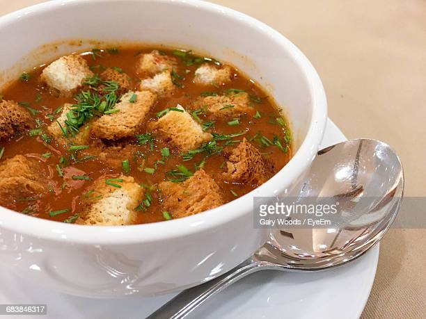 high angle view of soup with crouton in bowl on table - crouton stock photos and pictures