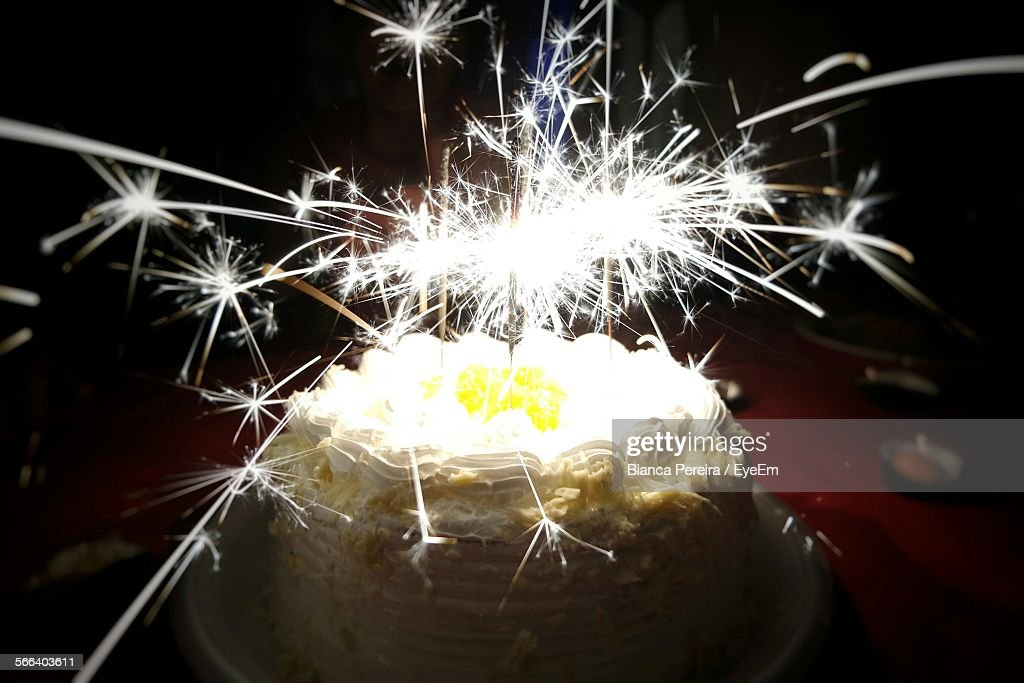 High Angle View Of Sparkler On Birthday Cake Stock Photo