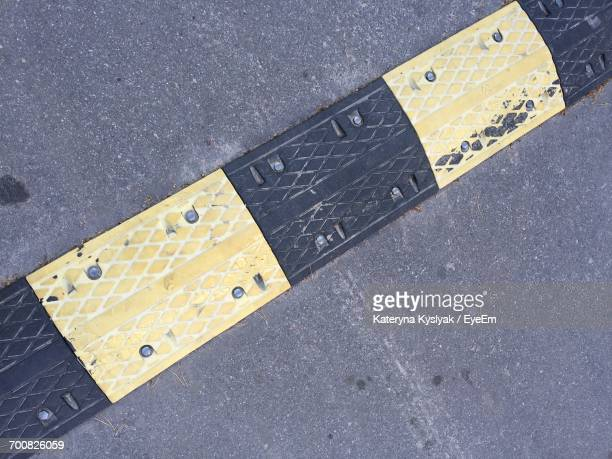 High Angle View Of Speed Bump On Road