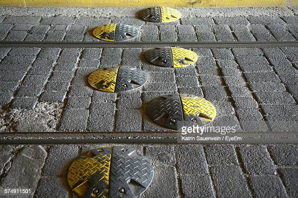 High Angle View Of Speed Bumps On Street