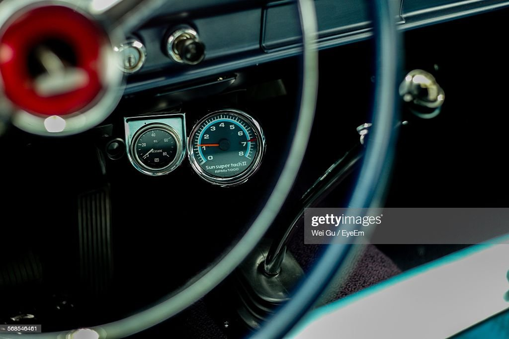High Angle View Of Speedometer On Dashboard Of Vintage Car : Stock Photo