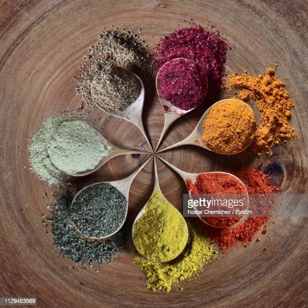 high angle view of spices on table - gewürz stock-fotos und bilder