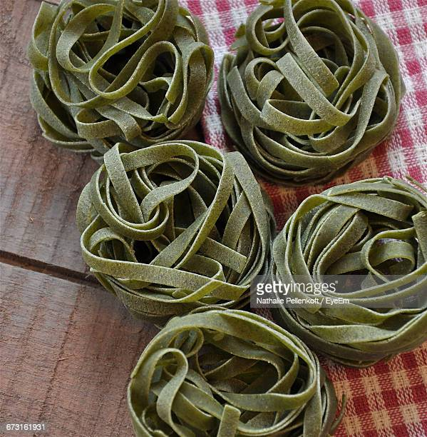 high angle view of spinach tagliatelle on table - nathalie pellenkoft stock pictures, royalty-free photos & images