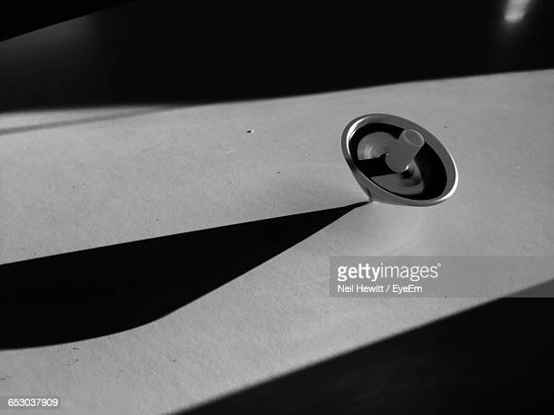 High Angle View Of Spinning Top On Table During Sunny Day