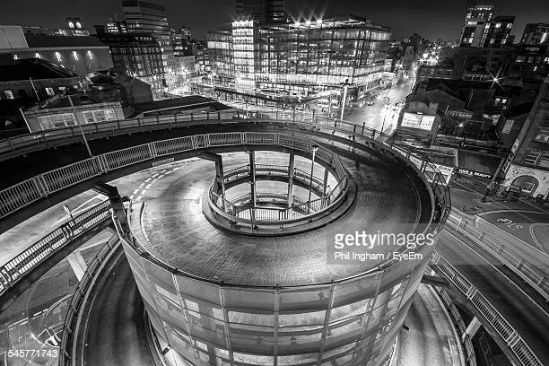 High Angle View Of Spiral Car Park In Illuminated City