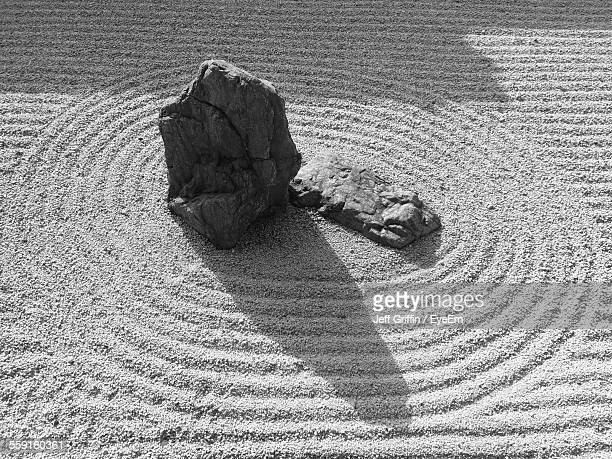 High Angle View Of Spiral Pattern Around Rocks