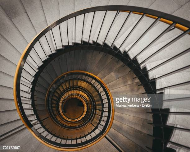 high angle view of spiral stairs - concentric stock pictures, royalty-free photos & images