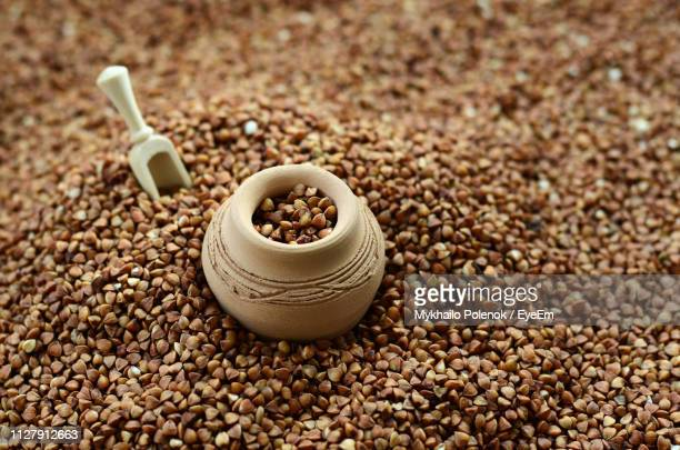 high angle view of spoon and container on buckwheat - buckwheat stock pictures, royalty-free photos & images