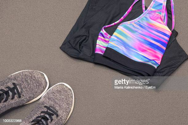 high angle view of sports clothing with shoes on floor - スポーツウェア ストックフォトと画像
