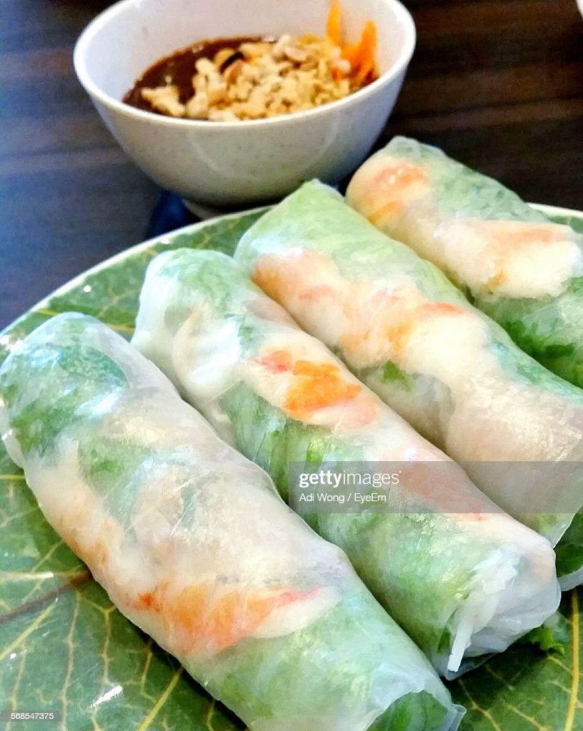 High Angle View Of Spring Rolls Served In Plate On Table : Stock Photo