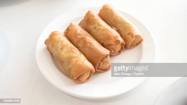 High Angle View Of Spring Rolls Served In Plate On Table