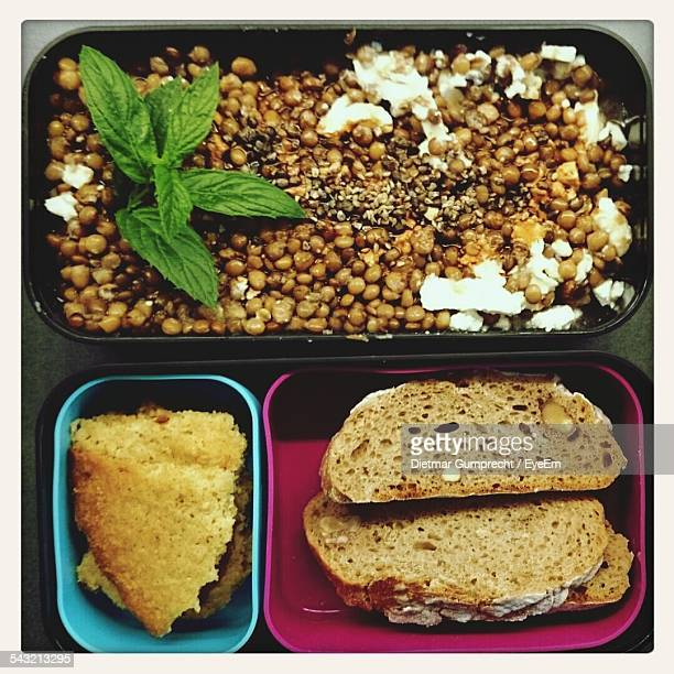 High Angle View Of Sprouts And Bread In Lunch Box