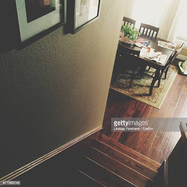 High Angle View Of Staircase And Dinning Table At Home