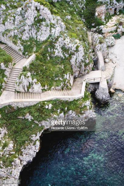 High Angle View Of Stairway On Cliff By Sea