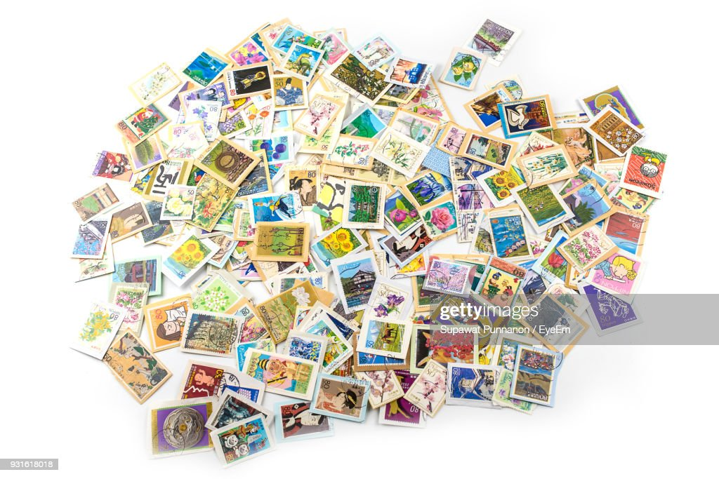 High Angle View Of Stamps Collection Over White Background : Stock Photo