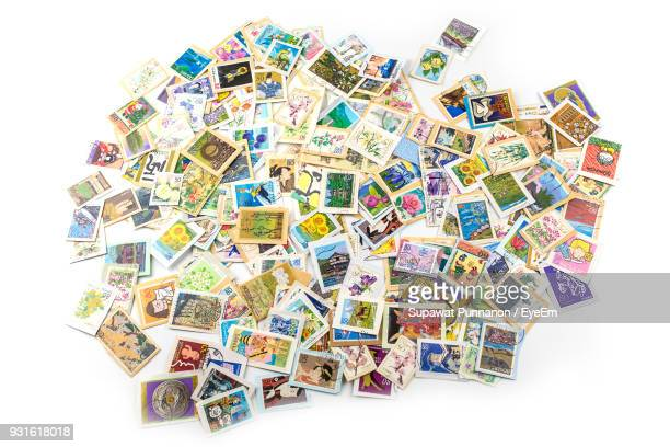 High Angle View Of Stamps Collection Over White Background