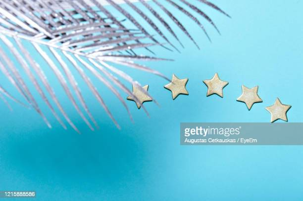 high angle view of star shape over blue background - cetkauskas stock pictures, royalty-free photos & images