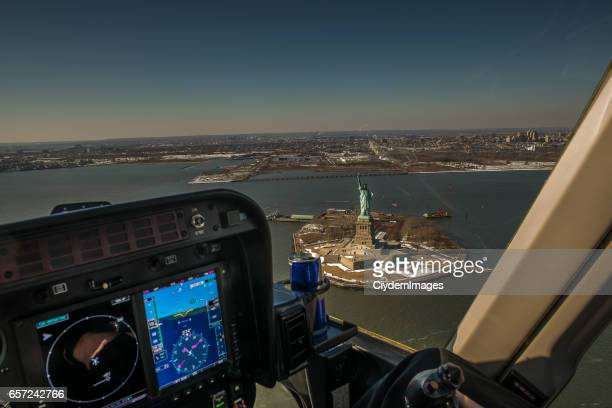 high angle view of statue of liberty from helicopter - inside helicopter stock pictures, royalty-free photos & images