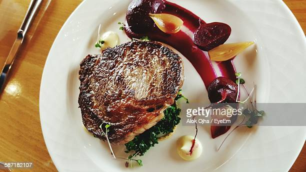 High Angle View Of Steak Served In Plate On Table