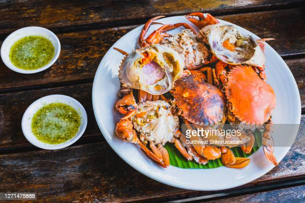 high angle view of steamed egg crab with spicy sauce, thailand seafood - crab stock pictures, royalty-free photos & images