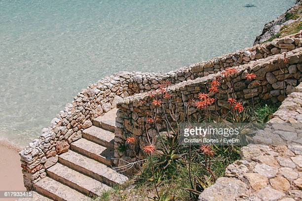high angle view of steps against sea at majorca - bortes stockfoto's en -beelden