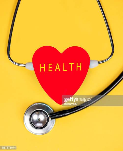 High Angle View Of Stethoscope And red Heart with text. Medical concept