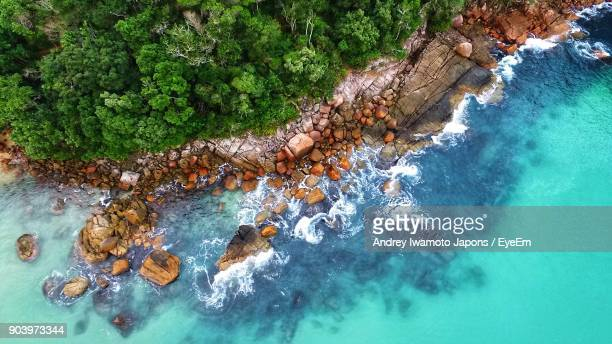 High Angle View Of Stones On Shore
