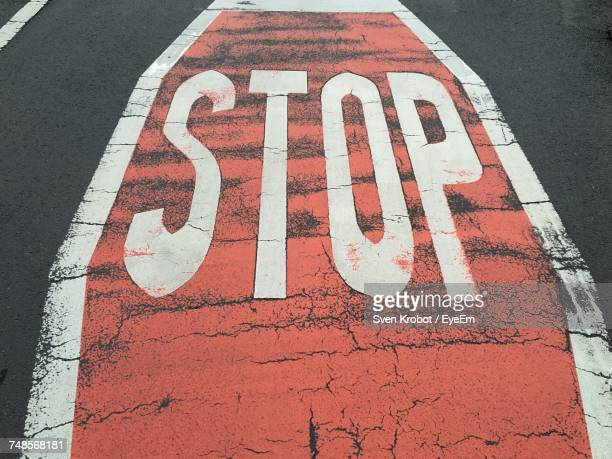 High Angle View Of Stop Sign On Road