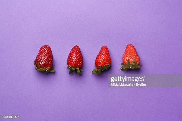 High Angle View Of Strawberries Against Purple Background