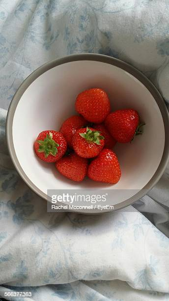 high angle view of strawberries in bowl on bed - mcconnell stock pictures, royalty-free photos & images