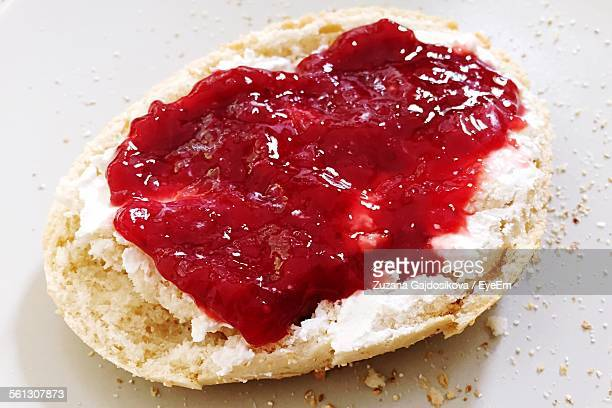 High Angle View Of Strawberry Jam On Bread