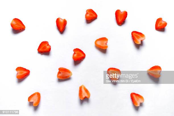high angle view of strawberry slices over white background - strawberry stock pictures, royalty-free photos & images