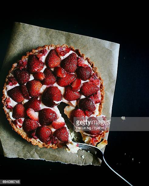 High Angle View Of Strawberry Tart On Wax Paper