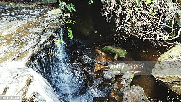 High Angle View Of Stream Amidst Rocks