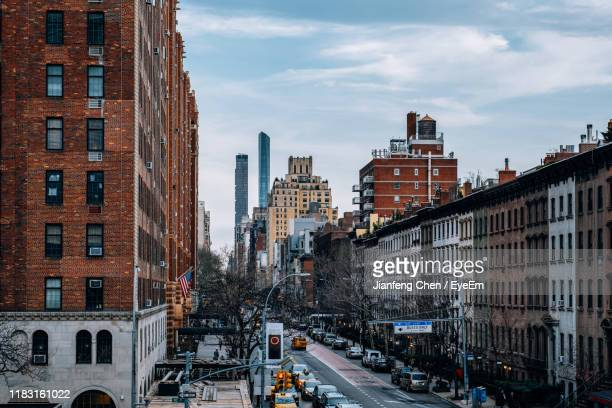 high angle view of street amidst buildings against sky - chelsea stock pictures, royalty-free photos & images
