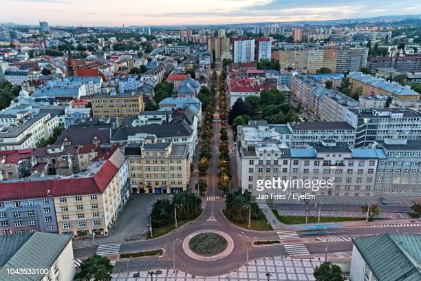 high angle view of street amidst buildings in city - ostrava stock pictures, royalty-free photos & images