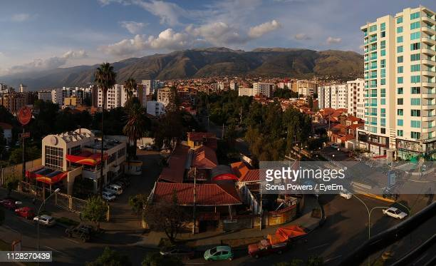 high angle view of street amidst buildings in city - cochabamba stock pictures, royalty-free photos & images