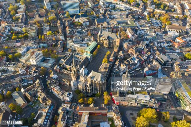 high angle view of street amidst buildings in city - aachen stock pictures, royalty-free photos & images
