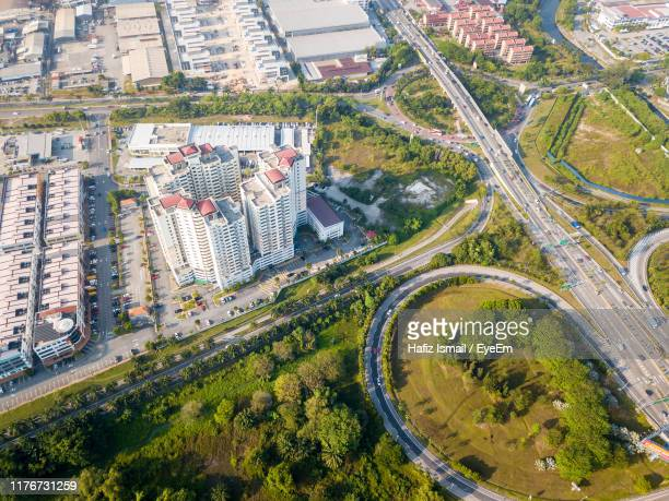 high angle view of street amidst buildings in city - shah alam stock photos and pictures