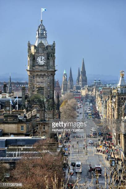 high angle view of street amidst buildings in city - richard flint stock pictures, royalty-free photos & images
